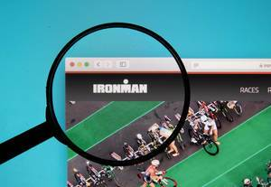 Ironman logo on a computer screen with a magnifying glass
