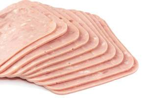 Isolated Sliced Square Ham above white background (Flip 2019)