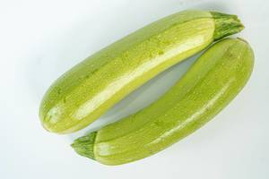 Isolated Zucchini above white background