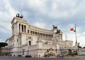 Italian Parliament Building in Downtown Rome with Italian Flag on Flag Pole at Cloudy Weather