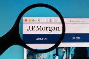 J.P. Morgan logo under magnifying glass