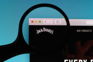 Jack Daniels logo under magnifying glass