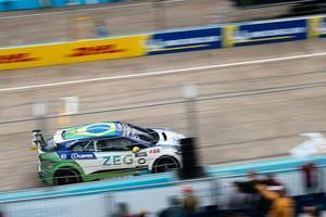 Jaguar i-Pace race car drives fast by fan stands