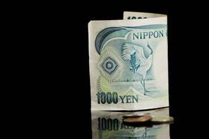 Japanese currency, Yen, on black background