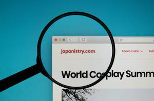 Japanistry website on a computer screen with a magnifying glass