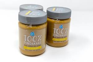 Jars of pure pindakaas, peanut butter in Dutch, with pieces