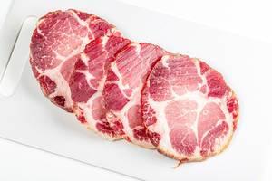 Jerky pork meat on a white kitchen board