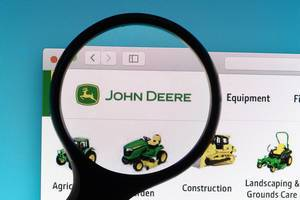 John Deere logo under magnifying glass