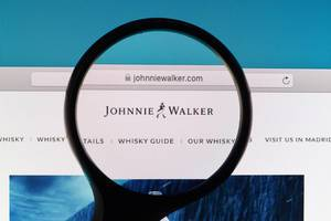 Johnnie Walker logo under magnifying glass