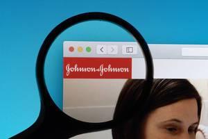 Johnson & Johnson logo under magnifying glass