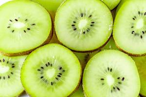 Juicy ripe slices of kiwi background