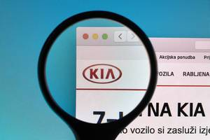 KIA logo under magnifying glass