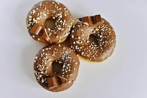Kinder chocolate tasting fresh Donuts