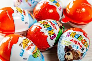 Kinder surprises background - chocolate eggs and kinder joy