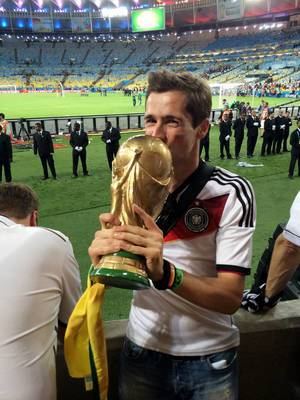 Kissing a replica of the FIFA cup – FIFA World Cup 2014, Brazil