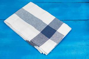 Kitchen Dishcloth in blue and white color on the wooden table (Flip 2020)