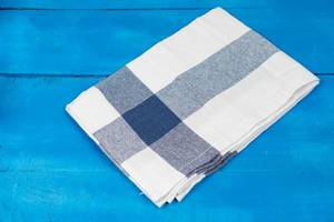 Kitchen Dishcloth in blue and white color on the wooden table