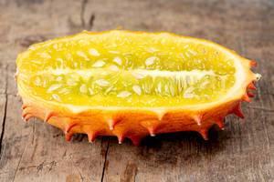 Kiwano fruit half on old wooden background (Flip 2020)