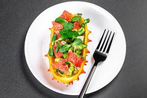 Kiwano with avocado, grapefruit and sunflower microgreen. Healthy eating concept (Flip 2020)