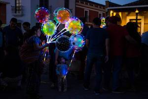 Lady selling illuminated balloons