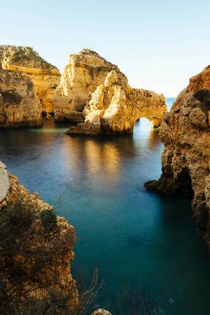 Lagoon with rorck formations near Lagos, Portugal  Flip 2019