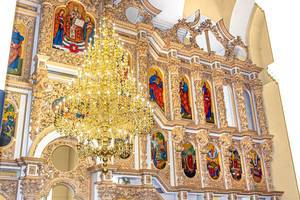Large chandelier in the Church on the background of Christian icons