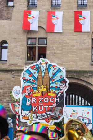 """Large colourful sign with an illustration of the Cologne Cathedral and the words """"D"""