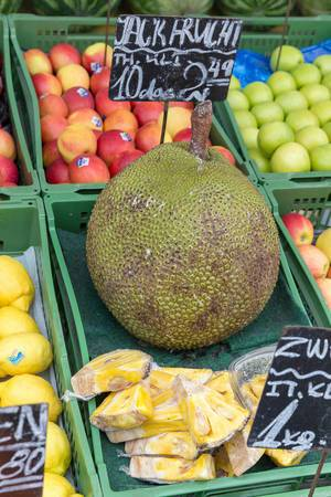 Large jackfruit at a fruit stand at Naschmarkt in Vienna