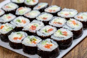 Large portion of Maki-rolls with salmon, avocado and cucumber (Flip 2019)