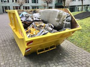 Large Yellow Trash Container filled with Construction Waste