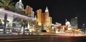 Las Vegas skyline with light trails and palms