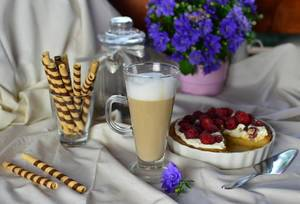 Latte coffee and tart with fruit