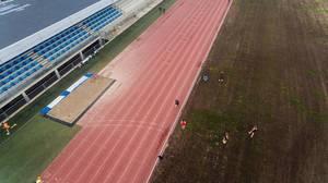 Laufbahn und Läufer beim Warmwerden - Magaluf, Mallorca