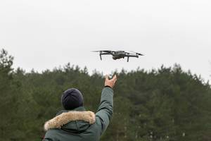 Launching drone takes off from the pilot