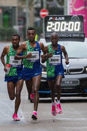 Leading Trio Dawit, Fikre and Martin at the two hour mark with the timing car in the background