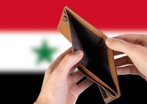 Leerer Geldbeutel aus Leder mit Flagge von Syrien. Rezession und Finanzkrise werden mit mehr Schulden und Bundeshaushaltdefizit einhergehen