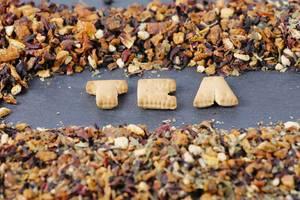 Letters TEA and dry tea leaves