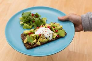 Light and healthy Meal: Avocado Sandwich with Salad and Pomegranate