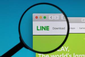 LINE logo under magnifying glass