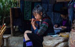 Little in Traditional Clothes playing flute