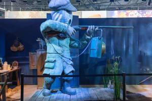 Little Nightmares 2 station with Hugh video game character statue at Gamescom