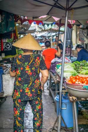 Local Vietnamese Woman at a Market in Chinatown Saigon