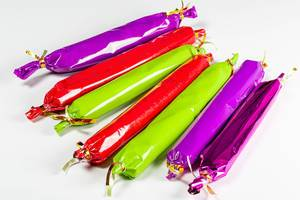 Long colored candies on a white background