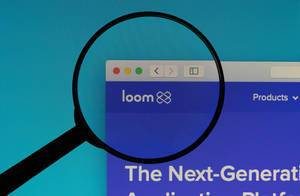Loom logo under magnifying glass