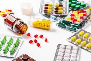 Lots of colorful and different shapes of pills, pills and capsules on white background