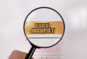 Lottery ticket and magnifying glass