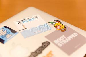 Macbook with Decals of startupvitamins: The best way to do it is to do it