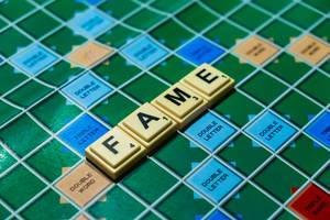 "Macro shot of ""Fame"" word on scrabble board"