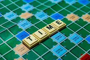 "Macro shot of ""Time"" word on scrabble board"