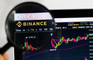 Magnifying glass over Binance logo